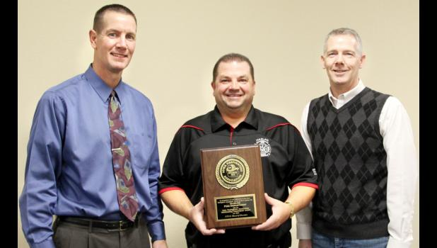 Picture of Harlan Fire Department receiving Fire Department of the Year from Iowa Fire Association.
