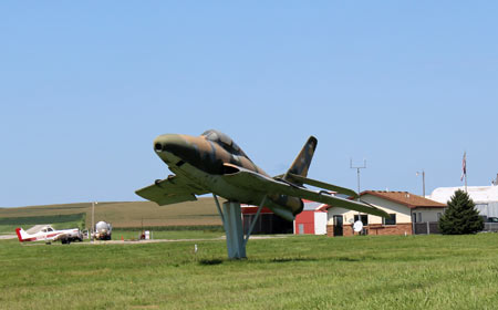 Picture of an old fighter jet at the Harlan Municipal Airport