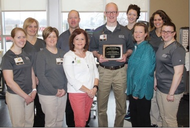 Picture of Myrtue Medical Center's Physical Therapy receiving 2016 Clinical Site of Excellence award from Creighton University.